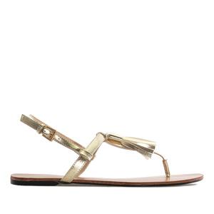 Letní sandále, tenké pásky a střapec na nártu. Zlaté.