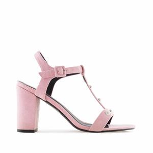 Vaaleanpunaiset T-remmi sandaalit.