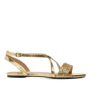 Kultaiset käärmeprintti sandaalit.