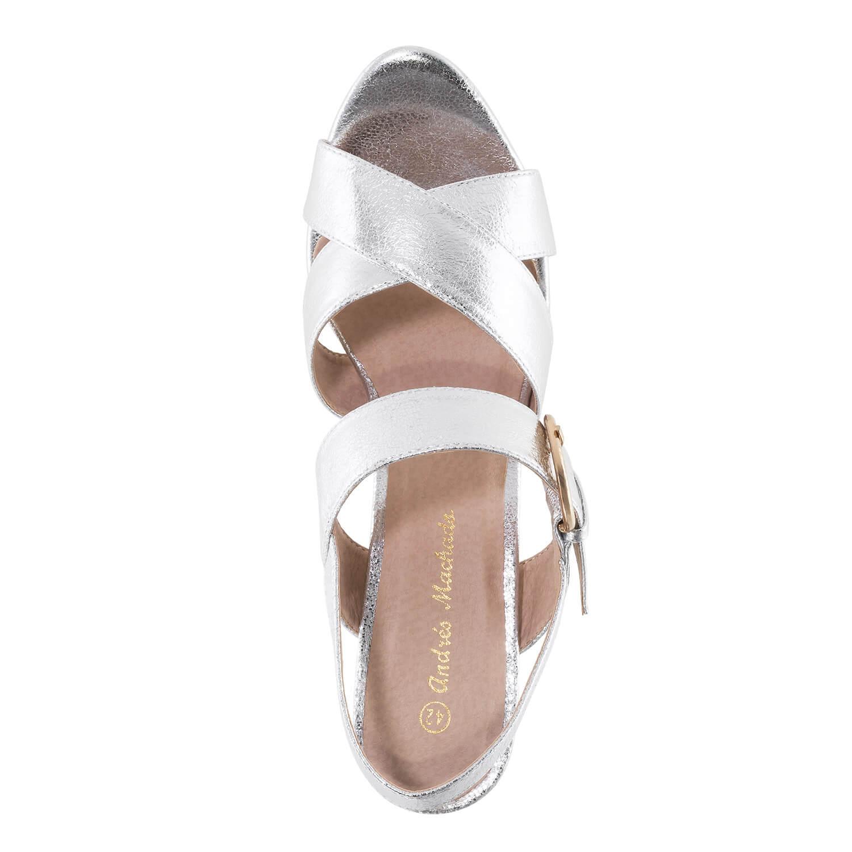 Hopeat korokepohja sandaalit.